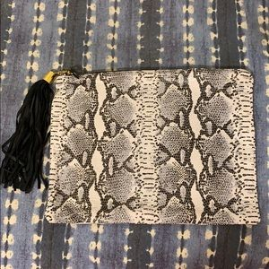 Blair Ritchey python leather clutch with tassel